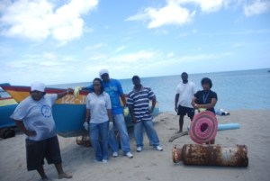 A team from the Fisheries Division moments after cleaning up the landing site at Jessups Bay on Community Outreach Day on May 11, 2016, an event in the Ministry of Agriculture's Agriculture Awareness Month 2016