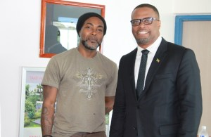 (L-r) Sylvester Meade, the Ministry of Tourism's 2016 Photographer of the Year with Tourism Minister Hon. Mark Brantley at the Vance W. Amory International Airport on May 31, 2016, to launch an exhibition showcasing Meade's photography