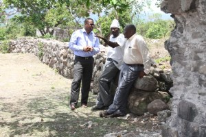 Deputy Premier of Nevis and Minister of Tourism Hon. Mark Brantley (l) and Permanent Secretary in the Ministry of Tourism Carl Williams discussing ongoing works at the New River Estate with a worker during a tour on June 28, 2016