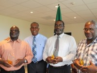 The Dore Brothers (left) Allister, Lanny (second from right) and Wrenford (right) showing off their individual tokens of appreciation rom the Nevis Island Administration for their contribution to music on Nevis with Premier of Nevis Hon. Vance Amory (second from left) at the St. Christopher and Nevis Social Security Board's conference room at Pinney's on October 25, 2016