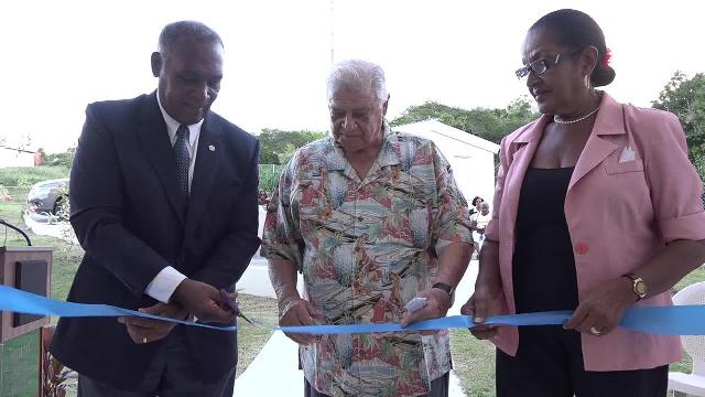 (L-r) Premier of Nevis Hon. Vance Amory cutting the ribbon to officially launch the hotel's extension of 12 rooms at a dedication ceremony on October 14, 2016, with Co-owner of the Mount Nevis Hotel Dr. Adly Meguid and Hotel Manager Jeanette Grell-Hull