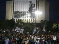 Images of Fidel Castro overlook the crowds gathered in Revolution Square, Havana