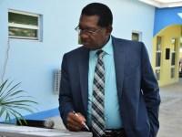 Sr. Minister of Health, Honourable Eugene Hamilton preparing for his presentation