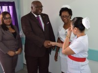 PM Dr. the Hon. Timothy Harris (brown suit) greets the doctor and nurses who will staff the Oncology Unit