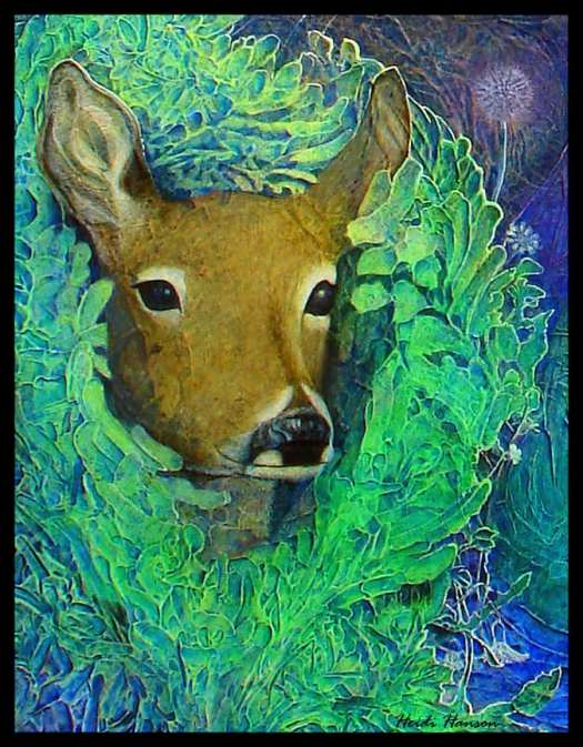 A deer's face looking out of some green bushes
