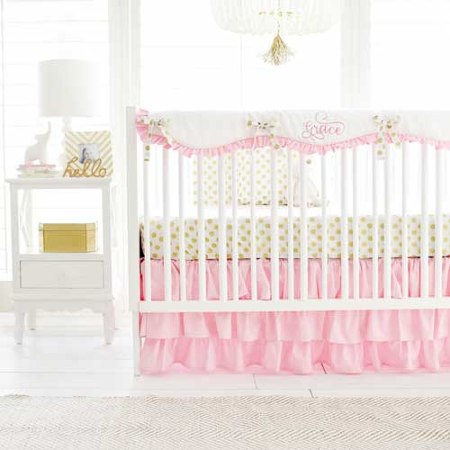 pink and gold crib
