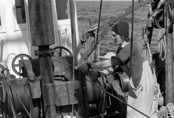 "Fisherman Paul Hirth operating winch to lower ""otter doors"" which will spread the net on the ocean floor. Photo by Joseph Thomas"