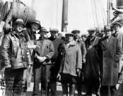 New Bedford fishermen leaving for Washington D.C. to testify in front of the Ways and Means Committee on the merits of British and American twine. Captain Mullins is third from left. April 20, 1933.
