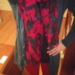 Wearing a flowery, bold colored scarf and a flowy cardigan is a great distraction from potential ostomy bulge.