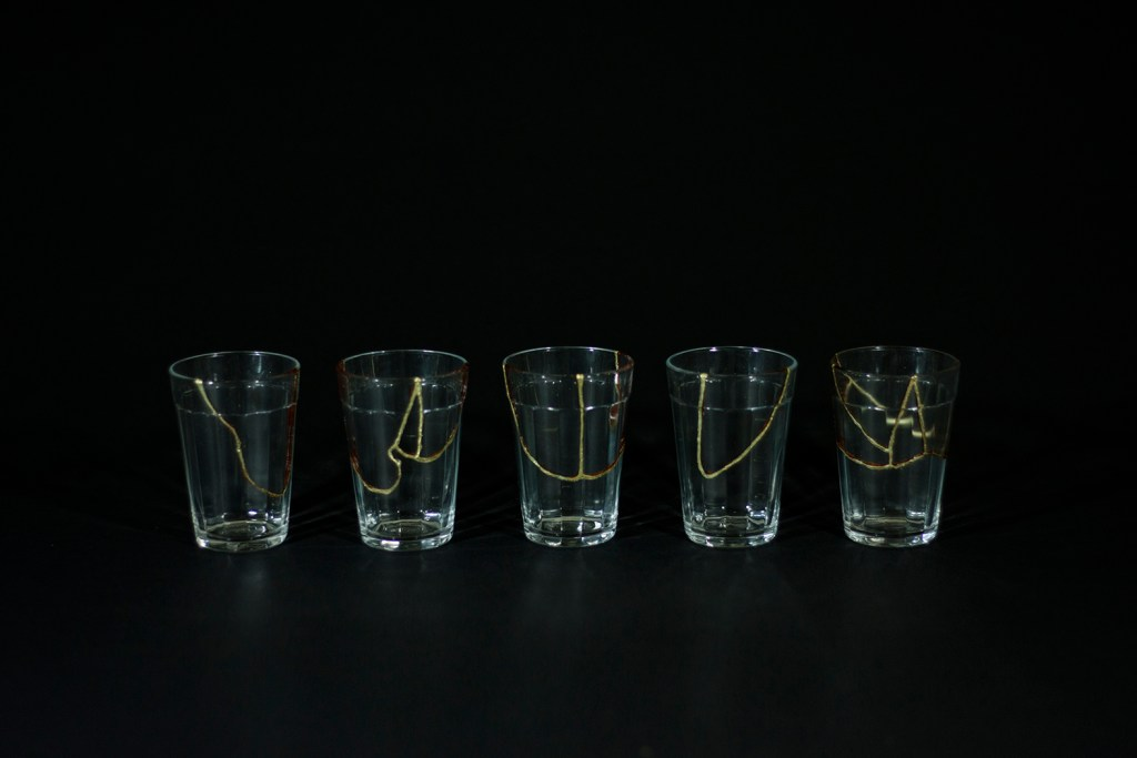 Not by great men, 2016, lacquer and sheet of gold on glass cup