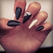 matte black and gold nail design