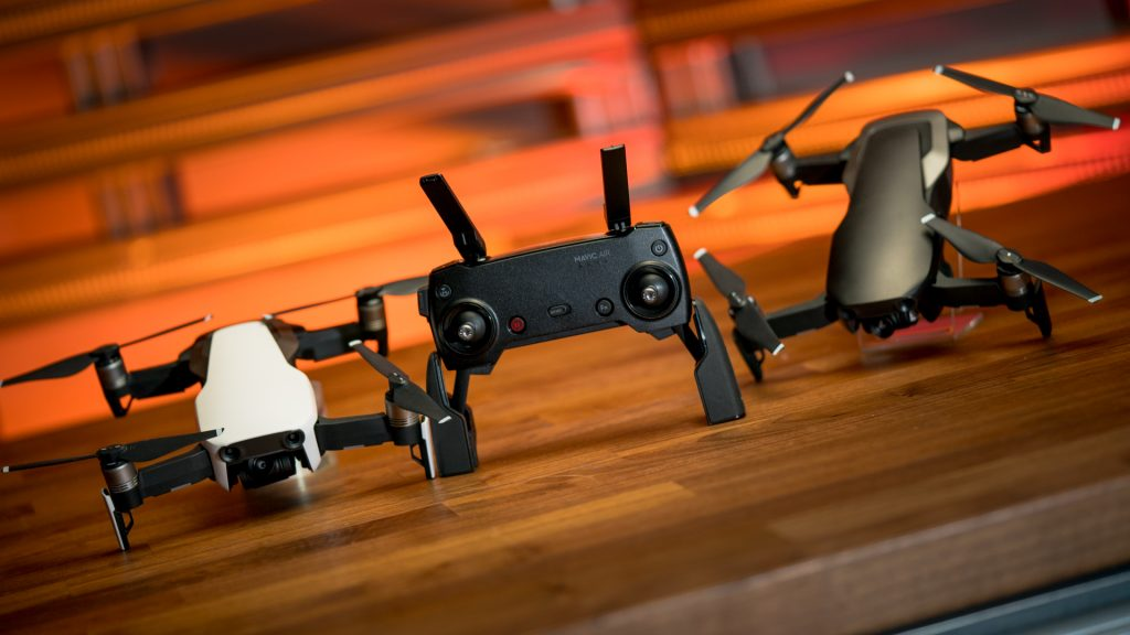DJI Mavic Air, drones, photography. The new DJI Mavic Air drones in Arctic White and Onyx Black sit with the collapsible remote, now potentially the most portable and capable photography drone.