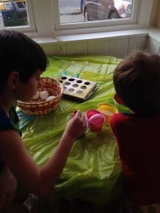 My boys dyeing Easter Eggs