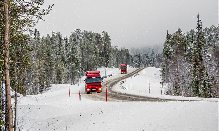 a truck travelling on an icy road in Russia