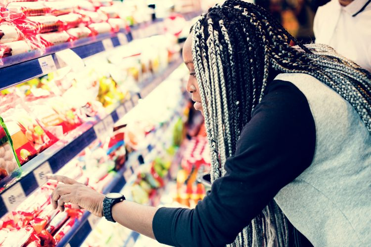 Lady looking at food in supermarket