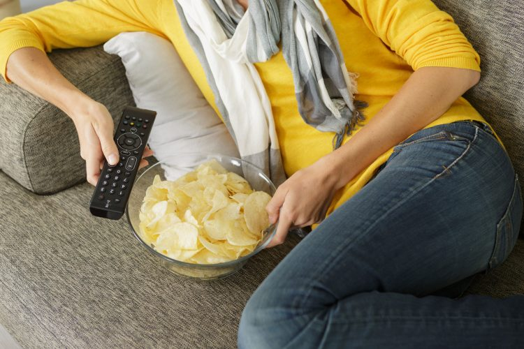 eating crisps on sofa