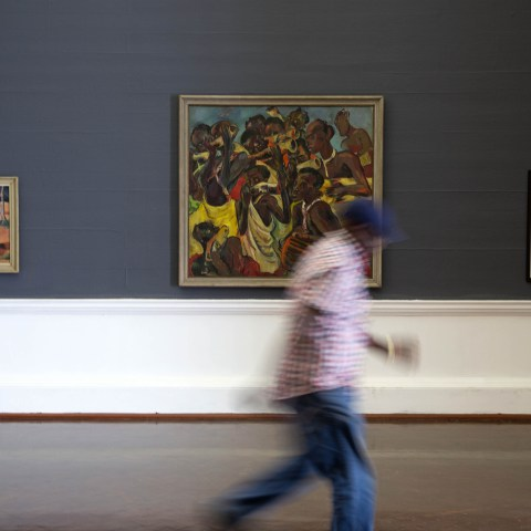 27 February 2019: (From left) A man moves past Maurice Van Essche's 'Native Woman' and Irma Stern's 'Bahutu Musicians' and 'Malay Bridesmaids', on show at the All Your Faves are Problematic' exhibition. (Photography by James Oatway)