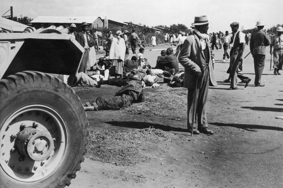 21 March 1960: The aftermath of Sharpeville, when police opened fire on a non-violent protest against laws requiring black South Africans to carry passes. (Photograph by Christie/ Central Press/ Getty Images)