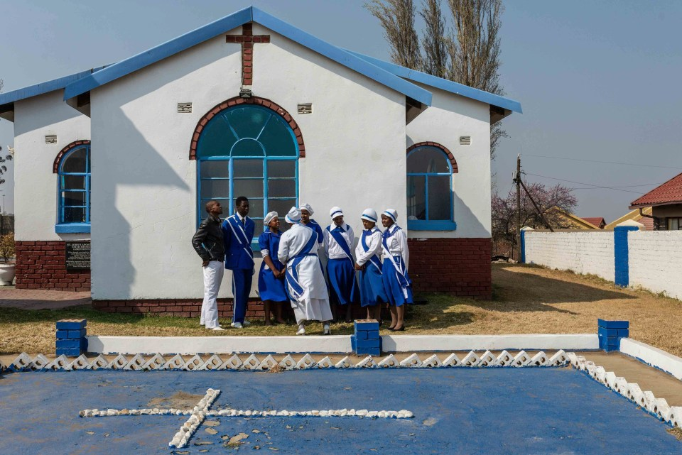 5 August 2018: Lethukuthula Thela is seen with fellow members of the church choir outside the premises of the St John's Apostolic Church in the township of Wesselton near Ermelo.
