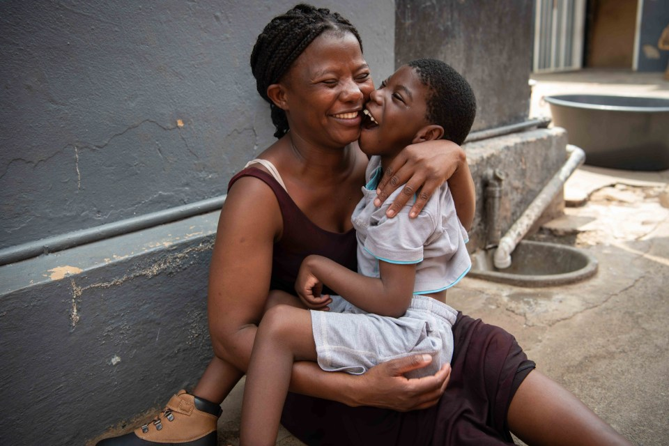 5 March 2019: Leah Ndanga and her son, Emmanuel, outside their home.