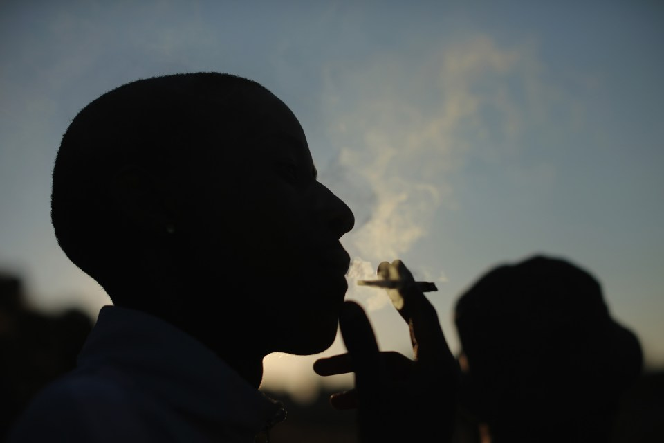 2 July 2013: A youth smokes weed in Soweto. Photo by Christopher Furlong/Getty Images.
