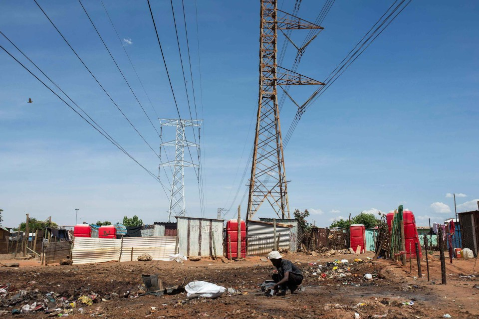 4 December 2018: The electric power lines that pass over some of the shacks at Vusimuzi in Ekurhuleni.