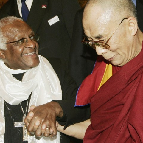 1 June 2006: The Dalai Lama (right) and Archbishop Desmond Tutu, who received a Light of Truth award to honour his contribution to the concept of Tibet, in Brussels, Belgium. (Photograph by Mark Renders/Getty Images)