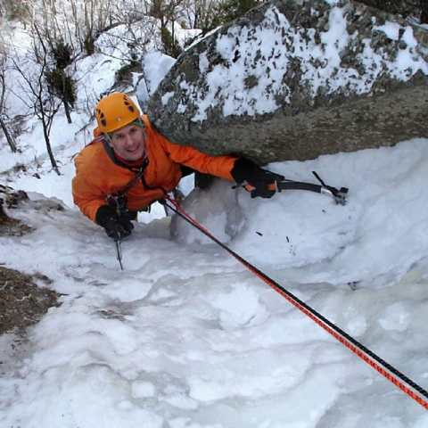 Ice climbing instruction and guided climb at Frankenstein Cliffs in Crawford Notch, New Hampshire.