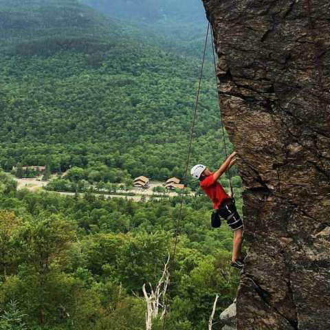 Top rope rock climbing on Square Ledge in Pinkham Notch, New Hampshire.