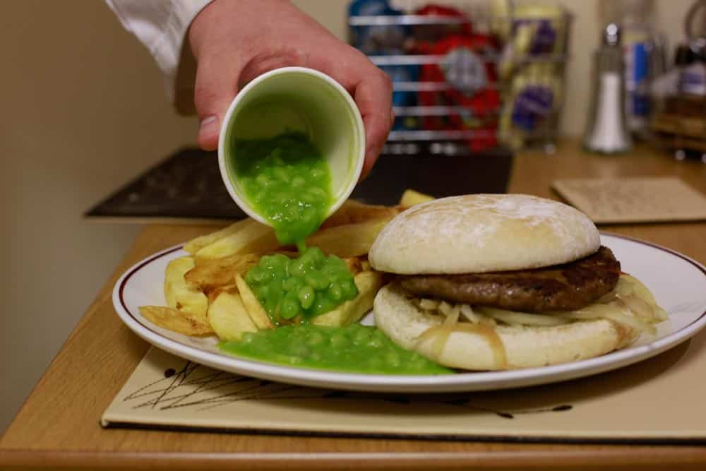 Homemade beef burger and chips, poured with the best mushy peas in the restaurant