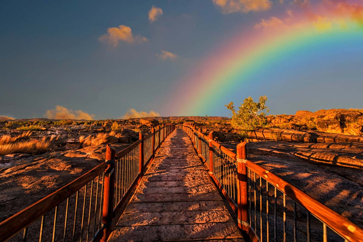 rainbow over a path at sunset