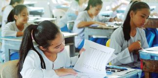 Malaysian students sitting for exam.