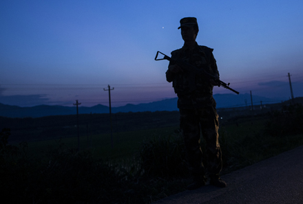A Chinese soldier patrols the border with Myanmar. Photo by AFP.