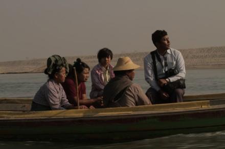 Myint Zaw (right) travels along the Irrawaddy river. Photo courtesy of Goldman Environmental Prize.