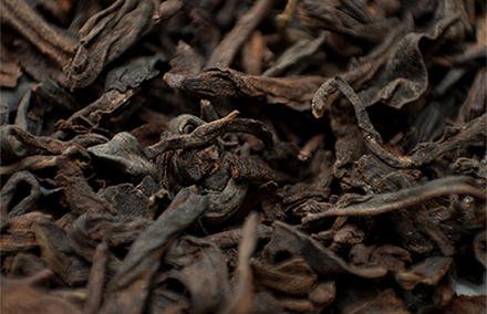 Puer tea leaves. Photo by Toby Oxborrow on flickr https://www.flickr.com/photos/oxborrow/