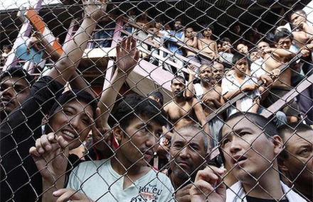 Men in an immigration detention centre, Malaysia. Photo by AP.