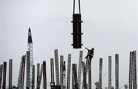 A worker at a port project in North Jakarta in January. Photo: Reuters.