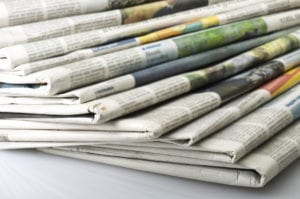 newspapers over white background.