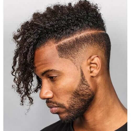 26. Afro-textured Side-swept Undercut with Short beard
