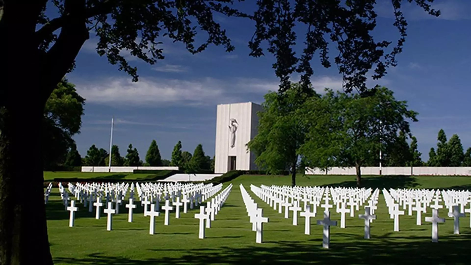 A military graveyard featuring dozens of white crosses.