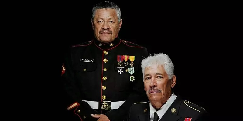Two veterans wearing military outfits