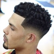 youthful 21 taper fade with curls
