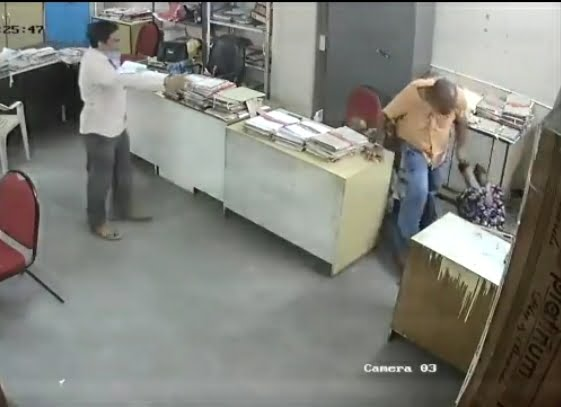 Duty manager Bhaskar beats Usha Rani, a female employee of tourism department, Nellore city
