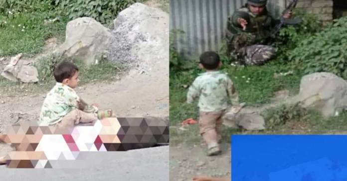 Three-Year-old Kashmiri baby wailing at the body of his grandfather