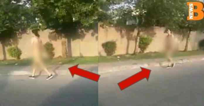 Woman walks naked on the road in Rawalpindi