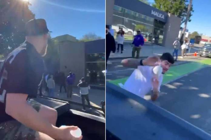 """The viral video shows Jake Paul drive by Conor McGregor friend Dillon Danis's video shoot and throws water balloon at Dillon and the film crew. Jake calls Dillon a """"p*ssy"""" then pleads for the driver to drive away"""