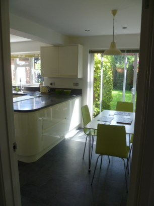 Handleless gloss kitchen living space