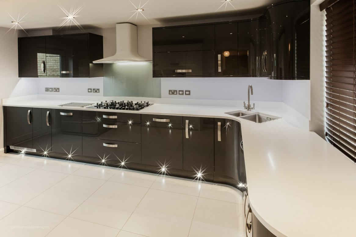 Ultra modern gloss kitchen in ely newrooms newrooms for Black gloss kitchen ideas