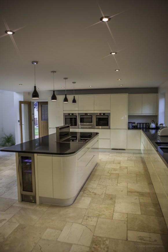 Ivory gloss handleless kitchen for newbuild