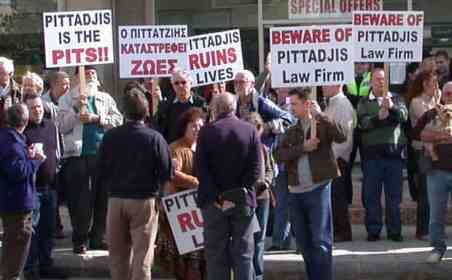 Protesters outside the Paphos offices of Photos Pittadjis